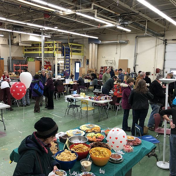 Visitors to the Repair Fair enjoy refreshments and get their items fixed