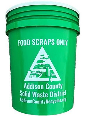Green five-gallon bucket for food scraps