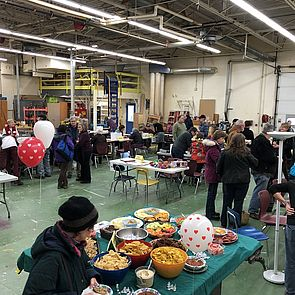 Repair Fair attendees enjoy refreshments and get items repaired by volunteers