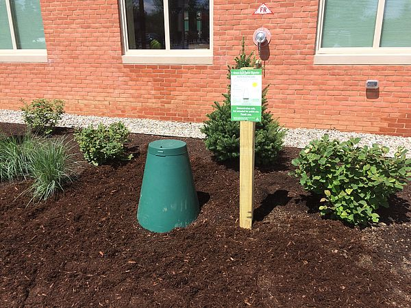 Green cone installed in garden bed behind Middlebury Town Offices