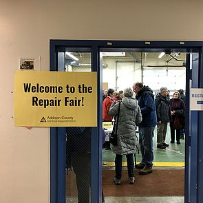 Welcome to the Repair Fair sign on doorway