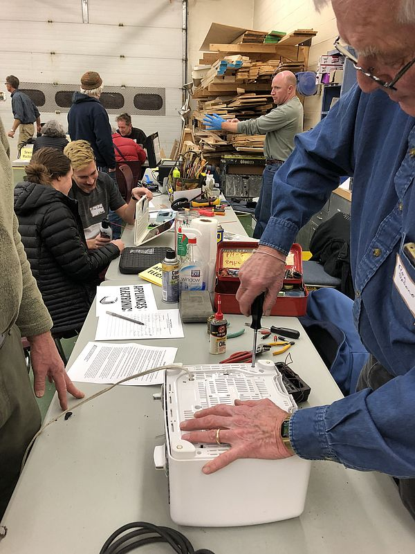 Repair Fair volunteers fix appliances and electronics