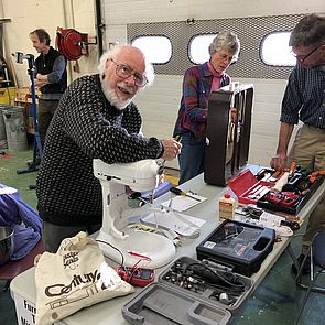 Volunteers fixing appliances at the February 2019 Repair Fair
